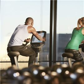 Group Spinning in Fitness Center with View